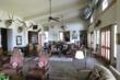 The lodge has 6 bedrooms and 5 1/2 baths along with a nice kitchen and grand living area with a large rock fireplace.