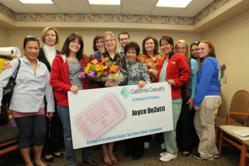 Winner Joyce DeZutti with the members of the Eating Disorders Program at Linden Oaks Hospital at Edward