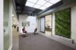 Upon entry to LPA's new Irvine space, visitors are greeted by a green wall meant to connect employees with nature while working inside.