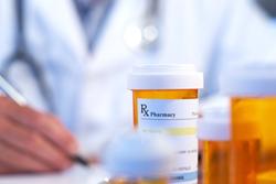 Doctor writing prescription for opioids.