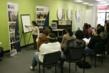 HOPE Financial Dignity Center staffer walks participants through a financial empowerment training seminar