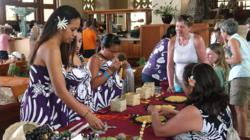 Demonstrating Niihau shell lei-making