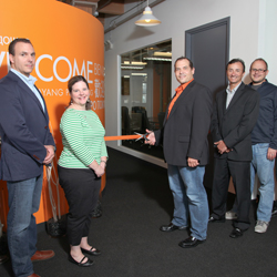 Ribbon cutting at new headquarters for Queue Marketing Communications.
