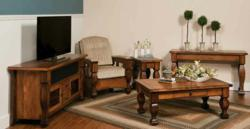 Rich wood carving and a sleek finish mark the Marriot Living Room Collection.