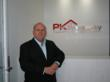 Mr. Peter Kelaher, innovative Director of PK Poperty Search & Negotiators in his Mosman, Sydney office.