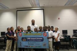 with Atlanta Falcons All-Pro Running Back Michael Turner and Donates 1,000 ClickN READ Licenses to MLK Jr. Elementary School