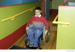 Child trying out a wheelchair at access/ABILITY