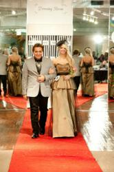 2012 Catwalk Competition Winner Sergio Armas with model Whitnee Richmond wearing the winning dress