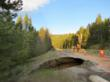 A 35-foot diameter sinkhole opened up along U.S. Highway 24 at Tennessee Pass in Western Colorado, caused by the collapse of an old railroad tunnel deep under the road platform.