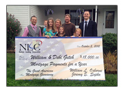 The Getch Family of Perry, Ohio holding the winning check, flanked by the founders of Nations Lending Corporation.