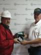 Randy McLarty of Bayer CropScience presents the thermal imaging scanner to Jamie Grey, Littlefield Fire Chief.