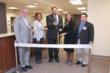 Mary Washington Healthcare Executives and Associates celebrate the expansion of Snowden at Fredericksburg behavioral health center with a ribbon cutting.