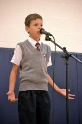 4th grader reciting a poem by Walt Whitman