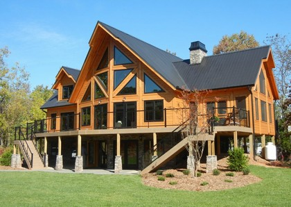 Manufacturer Of Unique Log Homes Formally Opens First U S