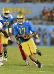 UCLA freshman quarterback and sibling advocate Brett Hundley in action
