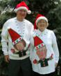 Picture of grandparents wearing matching ugly Christmas sweaters