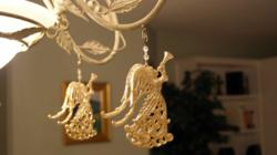 Magnetic crystal ornaments known as light charms transform home magnetic light charm gold angels on chandelier aloadofball Choice Image