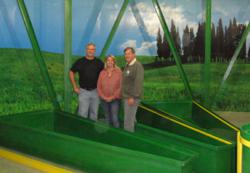 Larry Hall (left), developer of the Survival Condo, Rebecca Nelson and John Pade, Nelson and Pade, Inc.,  at the underground aquaponic farm in the Survival Condo.