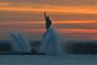 Lady Liberty watches over the ships on the New York Harbor.