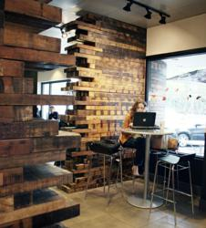 Trade Winds Patina deeply charactered wear layers were used to create this curving wall at a popular Seattle, WA coffee shop.