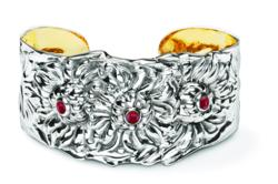 Three red cabochon garnets add extra grace to the exquisitely detailed slim cuff bracelet