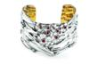 The silver cuff handcrafted in America now features red garnets for the holidays
