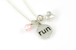 "The exclusive Inspired Endurance Race Charm Necklace on an 18"" sterling bead necklace comes with choice of race charm plus a sterling silver puff heart and choice of white or pink Swarovski pearl."