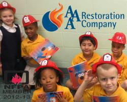Students at High Point Christian Academy in Stockbridge, Ga. receive AAA Restoration Company Fire Safety Coloring Books