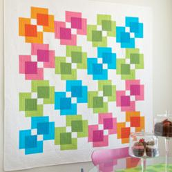 The AccuQuilt GO!® Fabric Cutter makes cutting the new Rectangle Reflection Quilt a breeze!