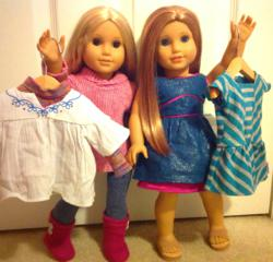 American Girl Dolls with outfits on doll clothes hangers