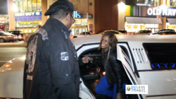 Qadir Muhammad helping his wife and Jay Z concert ticket winner, Kim Benson, out of limousine at the Barclays Center in Brooklyn