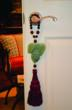 TRULYHUMANmedallion for Abundance featuring a grape cluster medallion hand carved from new jade.