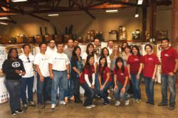 Employees from UnitedHealthcare and Orange County Digital Agency ymarketing help sort food at the Second Harvest Food Bank.