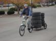 Optibikes have a large carrying capacity, having the ability to deliver large water containers and emergency supplies. The bike has the capacity to charge the battery with solar panels.