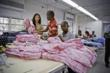 Workers in Haiti make GO Jammies with profits feeding area orphans.