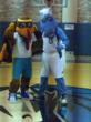 Tommy the Turkey and Champ from the Dallas Mavericks play nice on the court for a photo!