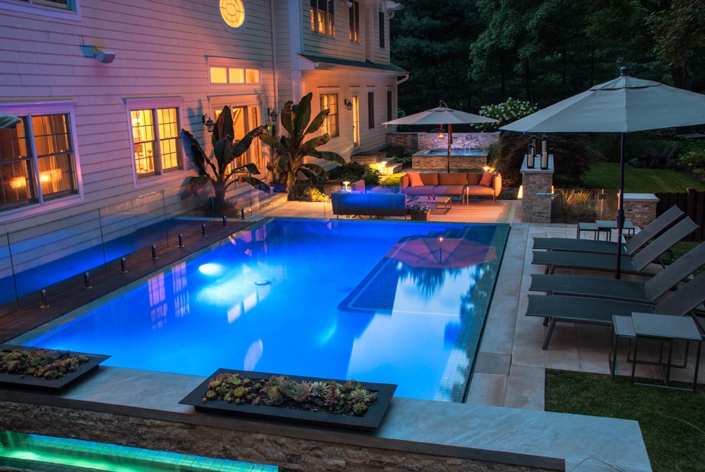 backyard designs with inground pools outdoor fireplace led pool lights illuminate the pool and spa