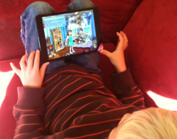 Child Reading a Book App on the iPad mini