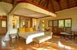 A thatch-roofed sanctuary at Chobe Chilwaro is luxurious to the last detail © Sanctuary Retreats