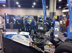 QuantumFlo's booth at this year's ASPE Convention included their company-sponsored 1000 horsepower super comp dragster.
