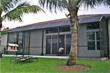An economical, custom-designed Venetian Builders, Inc., screened patio enclosure with insulated roof in Riviera Beach is complete after just two days of construction