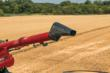 Operators can now control a pivoting grain spout on Case IH combines with the Multifunction Propulsion Handle, adjusting the flow of grain up to 3 feet without changing the speed of the grain cart or