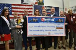 Thompson Electric, Plumbing, Heating and Cooling presenting a check to the Disabled Americans Veterans on November 12, 2012.