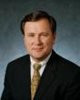 John P. Simcox, Vice President of Business Development