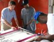 Volunteers learn how to save and restore historic windows at Adventures in Preservation project