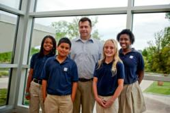 Christel House Academy Principal, Carey Dahncke, with students