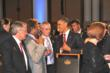 Kamahl shares a joke with President Obama.