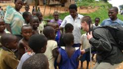 Craig Faris working with children in Africa