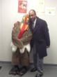 Dr. David Clark (right), CEO, Chester Community Charter School, poses with Chester C. Turkey, the school's Thanksgiving mascot (right), at its recent 13th Annual Thanksgiving Gift Certificate Giveaway