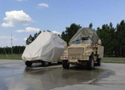 Transhield MRAP Cover Shown Next to Tradition Tarp